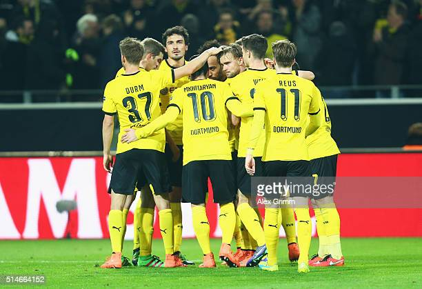 PierreEmerick Aubameyang of Borussia Dortmund is mobbed by team mates after scoring their first goal during the UEFA Europa League Round of 16 first...