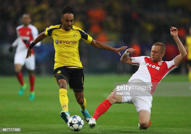 PierreEmerick Aubameyang of Borussia Dortmund is tackled by Kamil Glik of AS Monaco during the UEFA Champions League Quarter Final first leg match...