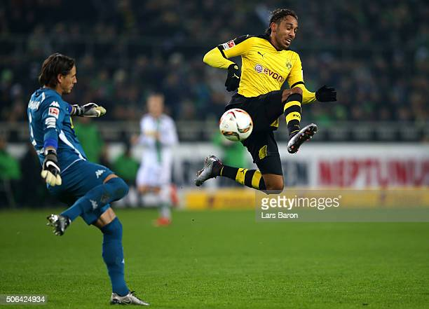 PierreEmerick Aubameyang of Borussia Dortmund jumps to block Yann Sommer of Borussia Moenchengladbach during the Bundesliga match between Borussia...