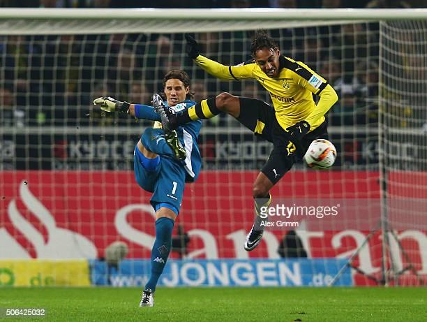 PierreEmerick Aubameyang of Borussia Dortmund jumps to block Yann Sommer of Borussia Moenchengladbach during the Bundesliga match between Borussia...