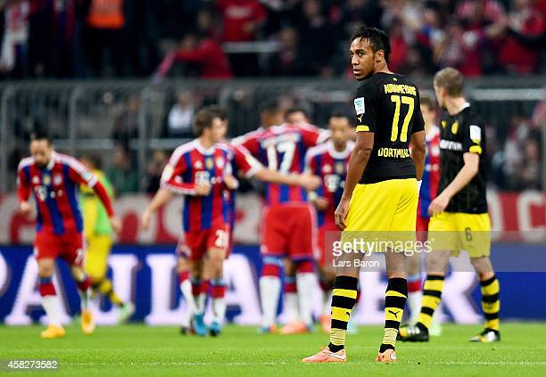 PierreEmerick Aubameyang of Borussia Dortmund looks dejetced after Robert Lewandowski of Bayern Muenchen scored a goal during the Bundesliga match...