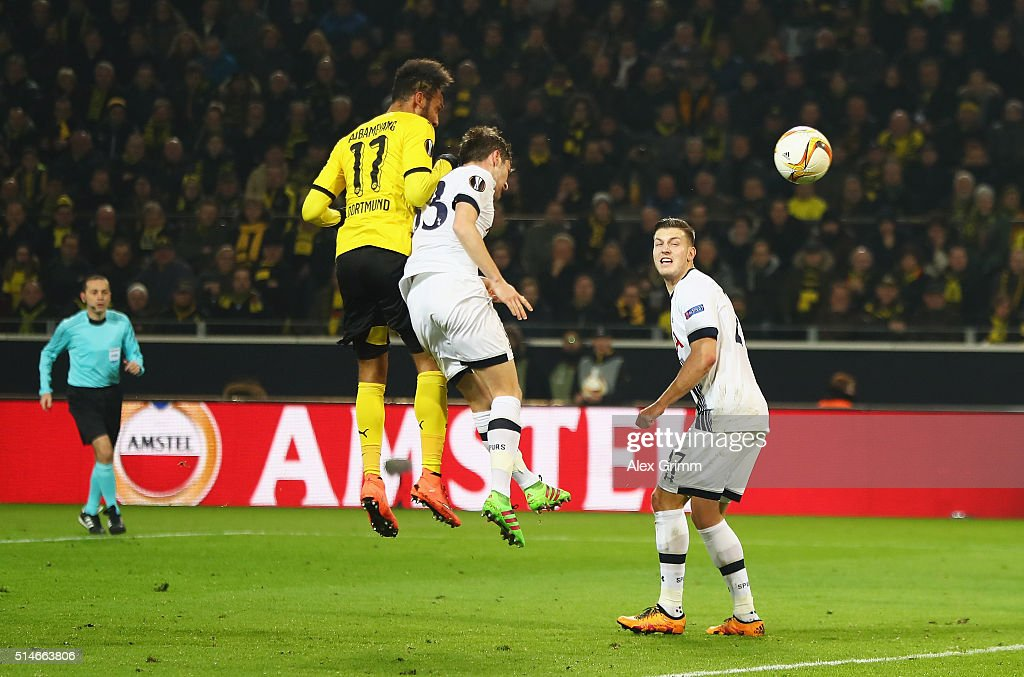Pierre-Emerick Aubameyang of Borussia Dortmund outjumps Ben Davies of Tottenham Hotspur as he scores their first goal during the UEFA Europa League Round of 16 first leg match between Borussia Dortmund and Tottenham Hotspur at Signal Iduna Park on March 10, 2016 in Dortmund, Germany.