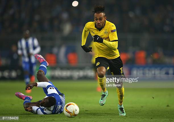 PierreEmerick Aubameyang of Borussia Dortmund runs past Silvestre Varela of FC Porto during the UEFA Europa League round of 32 first leg match...