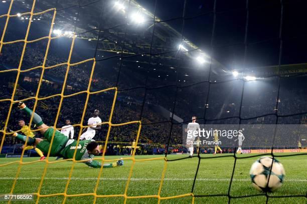 PierreEmerick Aubameyang of Borussia Dortmund scores his sides first goal past Hugo Lloris of Tottenham Hotspur during the UEFA Champions League...