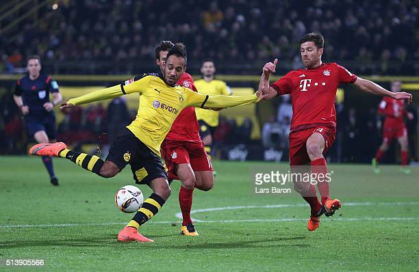 PierreEmerick Aubameyang of Borussia Dortmund shoots at goal during the Bundesliga match between Borussia Dortmund and FC Bayern Muenchen at Signal...