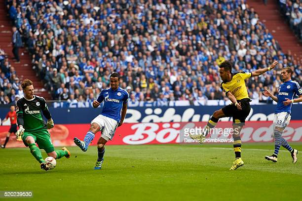 PierreEmerick Aubameyang of Borussia Dortmund shoots at Ralf Faehrmann of FC Schalke 04 during the Bundesliga match between FC Schalke 04 and...