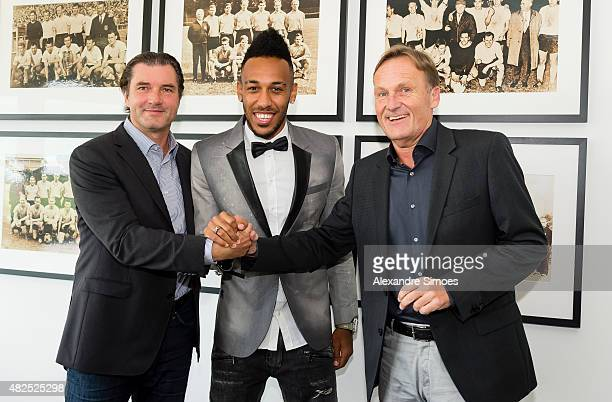 PierreEmerick Aubameyang of Borussia Dortmund signs Contract Extension for Borussia Dortmund with Michael Zorc and CEO of Borussia Dortmund...