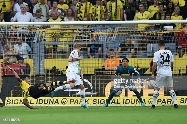 PierreEmerick Aubameyang of Borussia Dortmund takes a shot during the Bundesliga match between Borussia Dortmund and Borussia Moenchengladbach at...