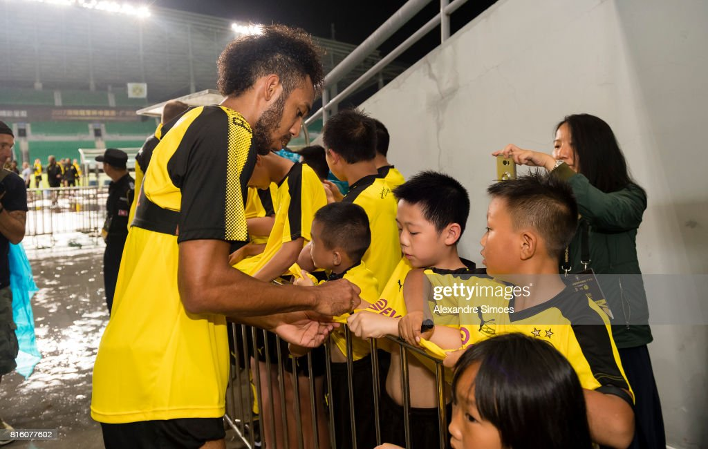 Pierre-Emerick Aubameyang of Borussia Dortmund together with some young chinese fans after a training session during the Borussia Dortmund Asian Summer Tour on July 17, 2017 in Guangzhou, China.