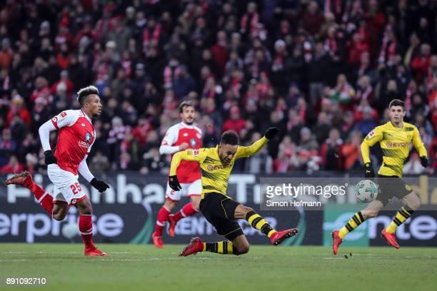 PierreEmerick Aubameyang of Borussia Dortmund tries to score next to JeanPhilippe Gbamin of FSV Mainz 05 during the Bundesliga match between 1 FSV...