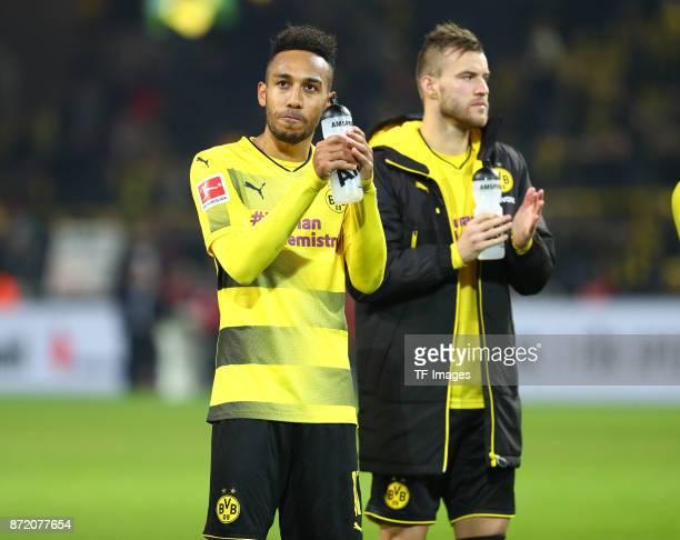 PierreEmerick Aubameyang of Dortmund and Andrey Yarmolenko of Dortmund looks dejected after the German Bundesliga match between Borussia Dortmund v...