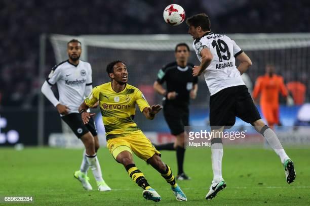 PierreEmerick Aubameyang of Dortmund and David Angel Abraham of Frankfurt battle for the ball during the DFB Cup final match between Eintracht...