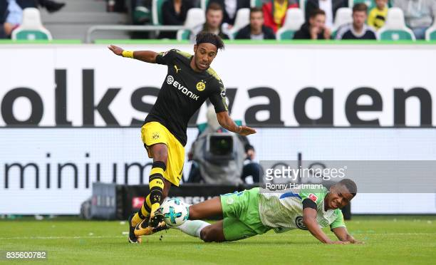 PierreEmerick Aubameyang of Dortmund and Felix Uduokhai of Wolfsburg compete during the Bundesliga match between VfL Wolfsburg and Borussia Dortmund...