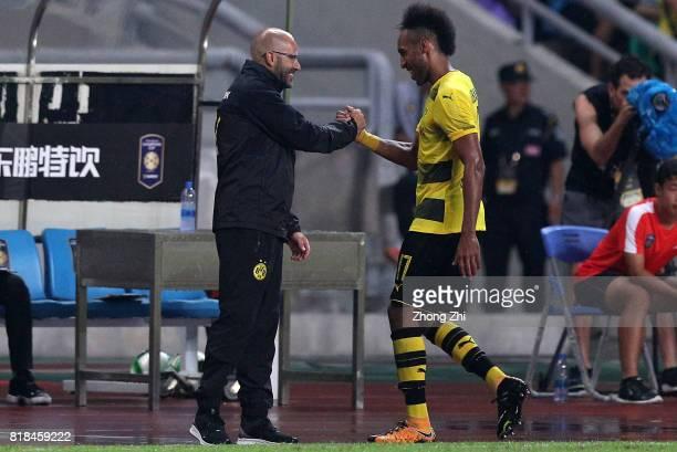 PierreEmerick Aubameyang of Dortmund and head coach Peter Bosz of Dortmund react during the 2017 International Champions Cup football match between...