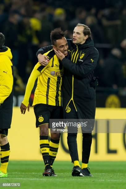 PierreEmerick Aubameyang of Dortmund and Head coach Thomas Tuchel of Dortmund celebrate their win during the Bundesliga match between Borussia...
