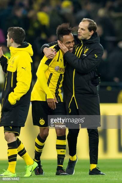 PierreEmerick Aubameyang of Dortmund and Head coach Thomas Tuchel of Dortmund celebrate their winduring the Bundesliga match between Borussia...