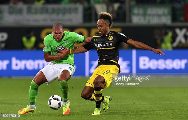 PierreEmerick Aubameyang of Dortmund and Jeffrey Bruma of Wolfsburg compete during the Bundesliga match between VfL Wolfsburg and Borussia Dortmund...