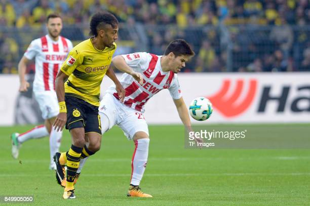 PierreEmerick Aubameyang of Dortmund and Jorge Meré / Mere of Koeln battle for the ball during the Bundesliga match between Borussia Dortmund and 1...