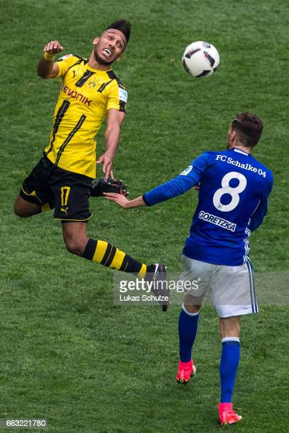 PierreEmerick Aubameyang of Dortmund and Leon Goretzka of Schalke in action during the Bundesliga match between FC Schalke 04 and Borussia Dortmund...