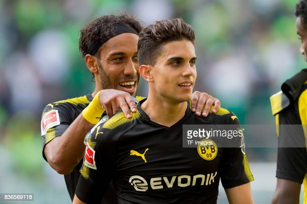 PierreEmerick Aubameyang of Dortmund and Marc Bartra of Dortmund celebrate their win during to the Bundesliga match between VfL Wolfsburg and...