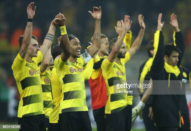 PierreEmerick Aubameyang of Dortmund and Maximilian Philipp of Dortmund celebrate with their team after the Bundesliga match between Borussia...