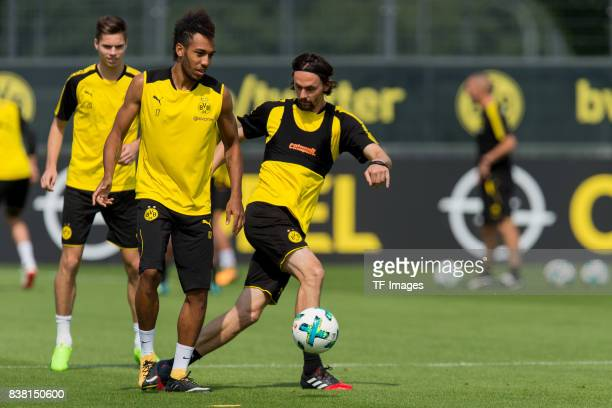PierreEmerick Aubameyang of Dortmund and Neven Subotic of Dortmund battle for the ball during a training session at the BVB Training center on August...
