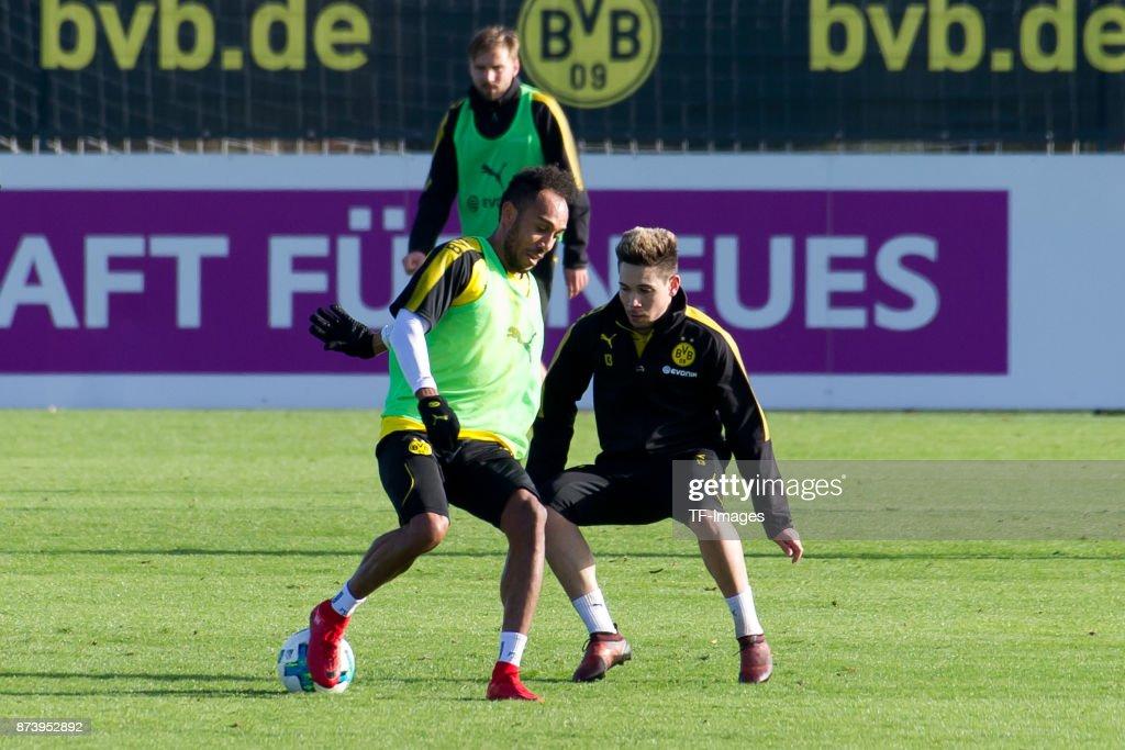 Pierre-Emerick Aubameyang of Dortmund and Raphael Guerreiro of Dortmund battle for the ball during a training session at BVB trainings center on November 5, 2017 in Dortmund.