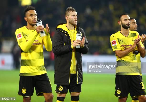PierreEmerick Aubameyang of Dortmund Andrey Yarmolenko of Dortmund and Oemer Toprak of Dortmund looks dejected after the German Bundesliga match...