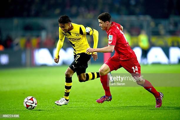 PierreEmerick Aubameyang of Dortmund battles for the ball with Jonas Hector of Koeln during the Bundesliga match between Borussia Dortmund and 1 FC...