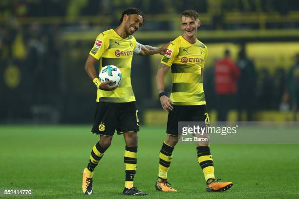 PierreEmerick Aubameyang of Dortmund carrier the ball and celebrates with Maximilian Philipp of Dortmund after the Bundesliga match between Borussia...