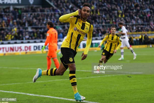 PierreEmerick Aubameyang of Dortmund celebrates after scoring a goal to make it 22 during the Bundesliga match between Borussia Moenchengladbach and...
