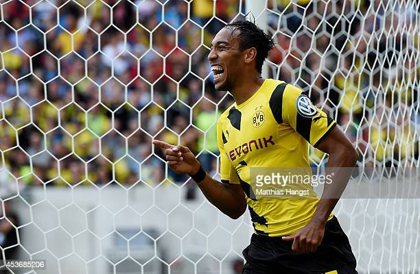 PierreEmerick Aubameyang of Dortmund celebrates after scoring his team's third goal during during the DFB Cup first round match between Stuttgarter...