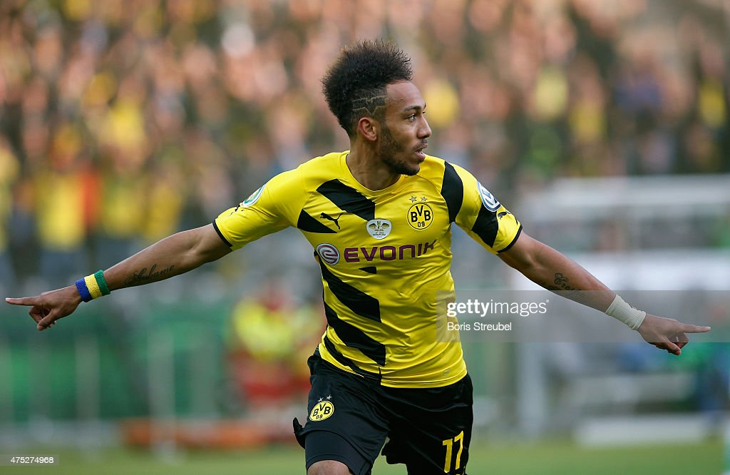 <a gi-track='captionPersonalityLinkClicked' href=/galleries/search?phrase=Pierre-Emerick+Aubameyang&family=editorial&specificpeople=6344916 ng-click='$event.stopPropagation()'>Pierre-Emerick Aubameyang</a> of Dortmund celebrates after scoring his team's first goal during the DFB Cup Final match between Borussia Dortmund and VfL Wolfsburg at Olympiastadion on May 30, 2015 in Berlin, Germany.