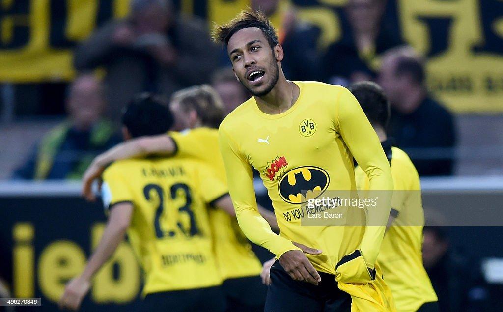 PierreEmerick Aubameyang of Dortmund celebrates after scoring his teams third goal during the Bundesliga match between Borussia Dortmund and FC...
