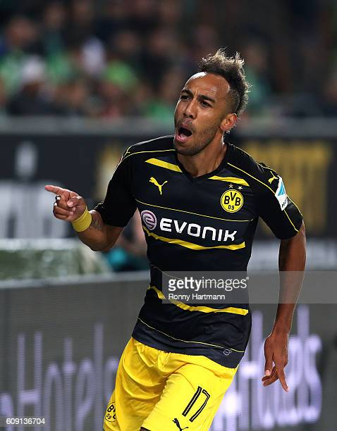 PierreEmerick Aubameyang of Dortmund celebrates after scoring his team's second goal during the Bundesliga match between VfL Wolfsburg and Borussia...