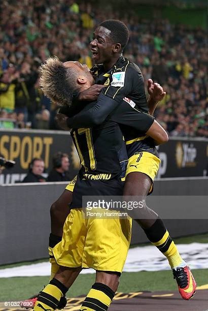 PierreEmerick Aubameyang of Dortmund celebrates after scoring his team's second goal with Ousmane Dembele of Dortmund during the Bundesliga match...