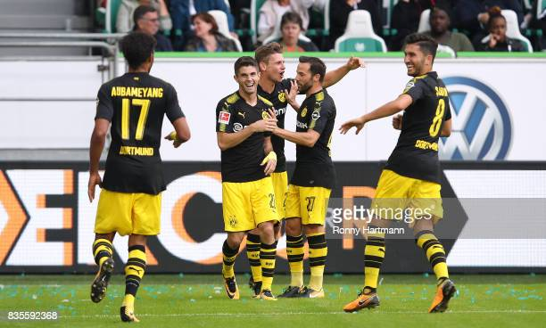 PierreEmerick Aubameyang of Dortmund celebrates after scoring his team's third goal with Christian Pulisic Lukasz Piszczek Gonzalo Castro and Nuri...