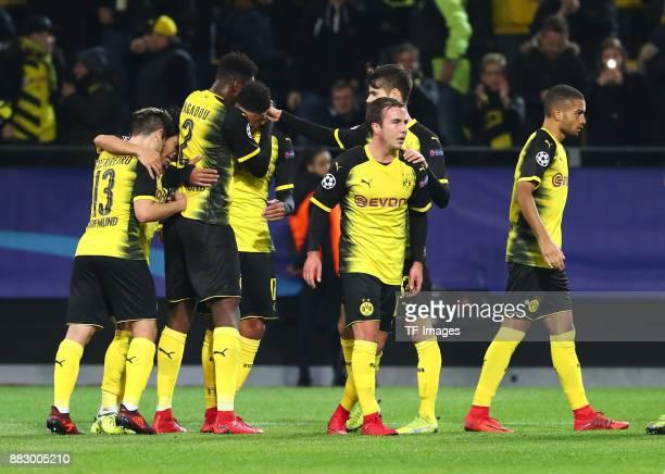 PierreEmerick Aubameyang of Dortmund celebrates after scoring his team`s first goal Raphael Guerreiro of Dortmund Shinji Kagawa of Dortmund DanAxel...