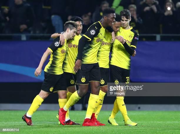 PierreEmerick Aubameyang of Dortmund celebrates after scoring his team`s first goal with Raphael Guerreiro of Dortmund Shinji Kagawa of Dortmund...