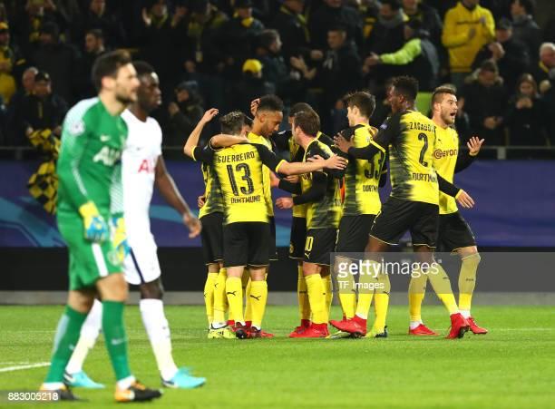 PierreEmerick Aubameyang of Dortmund celebrates after scoring his team`s first goal with Raphael Guerreiro of Dortmund Mario Goetze of Dortmund...