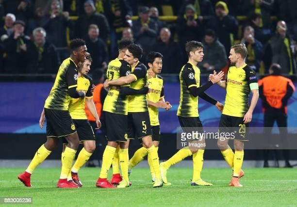 PierreEmerick Aubameyang of Dortmund celebrates after scoring his team`s first goal with DanAxel Zagadou of Dortmund Shinji Kagawa of Dortmund Marc...