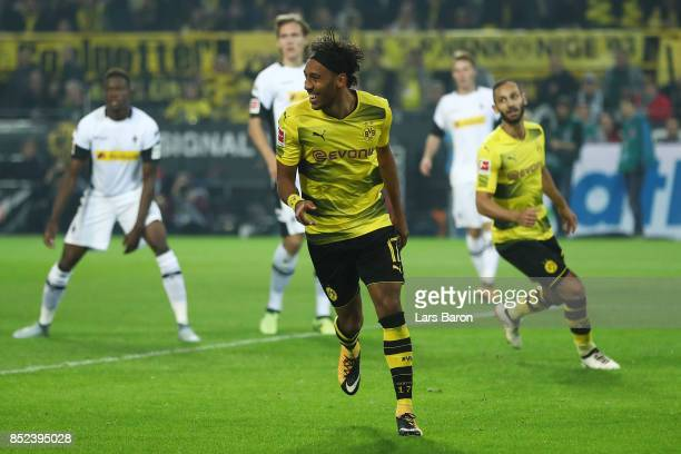 PierreEmerick Aubameyang of Dortmund celebrates his goal to make it 40 during the Bundesliga match between Borussia Dortmund and Borussia...
