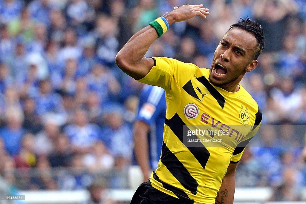 PierreEmerick Aubameyang of Dortmund celebrates his team's first goal during the Bundesliga match between FC Schalke 04 and Borussia Dortmund at...