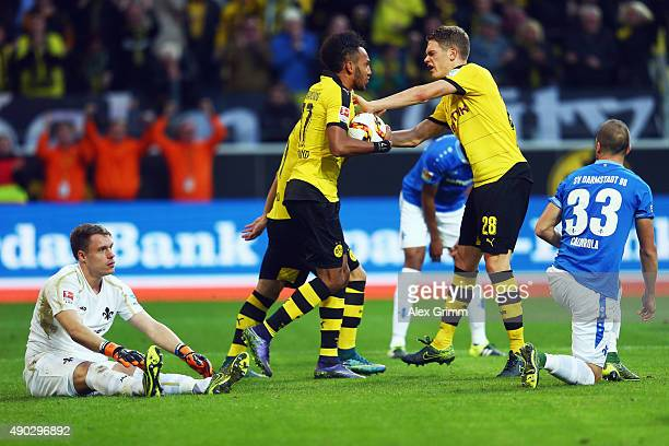 PierreEmerick Aubameyang of Dortmund celebrates his team's first goal with team mate Matthias Ginter during the Bundesliga match between Borussia...