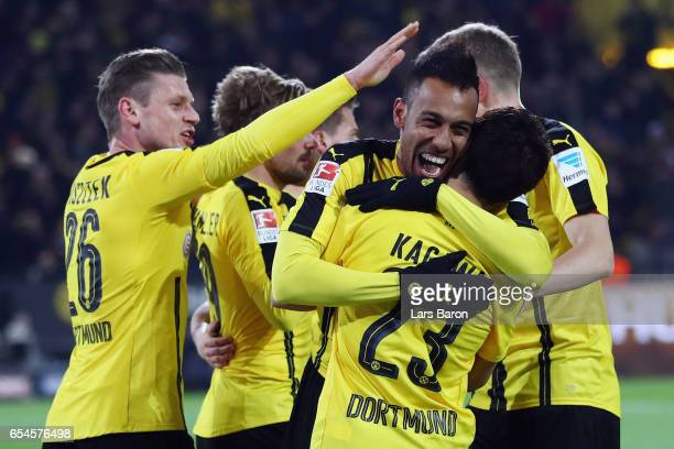 PierreEmerick Aubameyang of Dortmund celebrates his team's first goal with team mates during the Bundesliga match between Borussia Dortmund and FC...