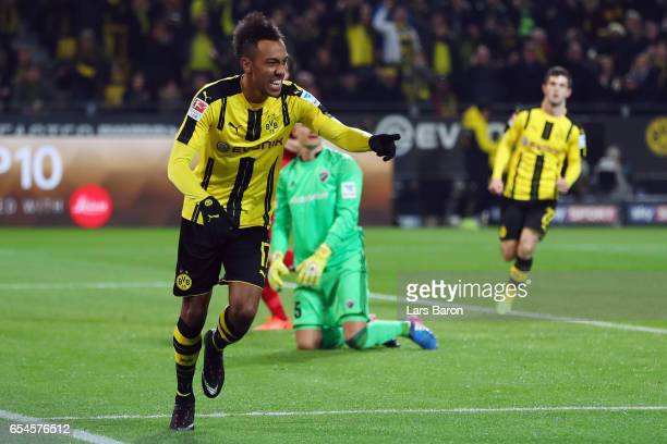 PierreEmerick Aubameyang of Dortmund celebrates his team's first goal during the Bundesliga match between Borussia Dortmund and FC Ingolstadt 04 at...