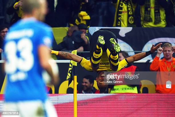 PierreEmerick Aubameyang of Dortmund celebrates his team's second goal as Luca Caldirola of Darmstadt reacts during the Bundesliga match between...