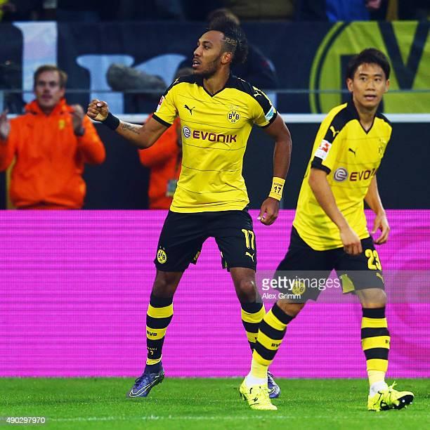 PierreEmerick Aubameyang of Dortmund celebrates his team's second goal with team mate Shinji Kagawa during the Bundesliga match between Borussia...
