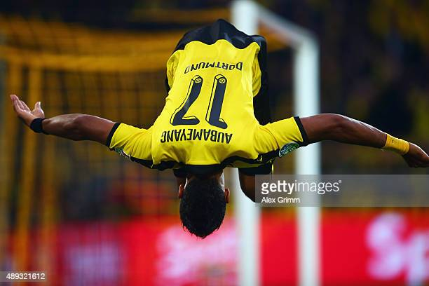 PierreEmerick Aubameyang of Dortmund celebrates his team's third goal during the Bundesliga match between Borussia Dortmund and Bayer Leverkusen at...