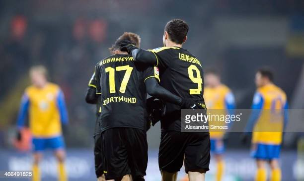 PierreEmerick Aubameyang of Dortmund celebrates scoring his first goal with Robert Lewandowski of Dortmund during the Bundesliga match between...